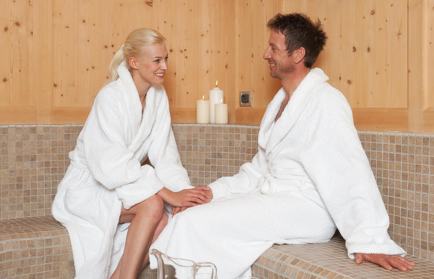 Couple relaxing in the sauna of Hotel Cavallino