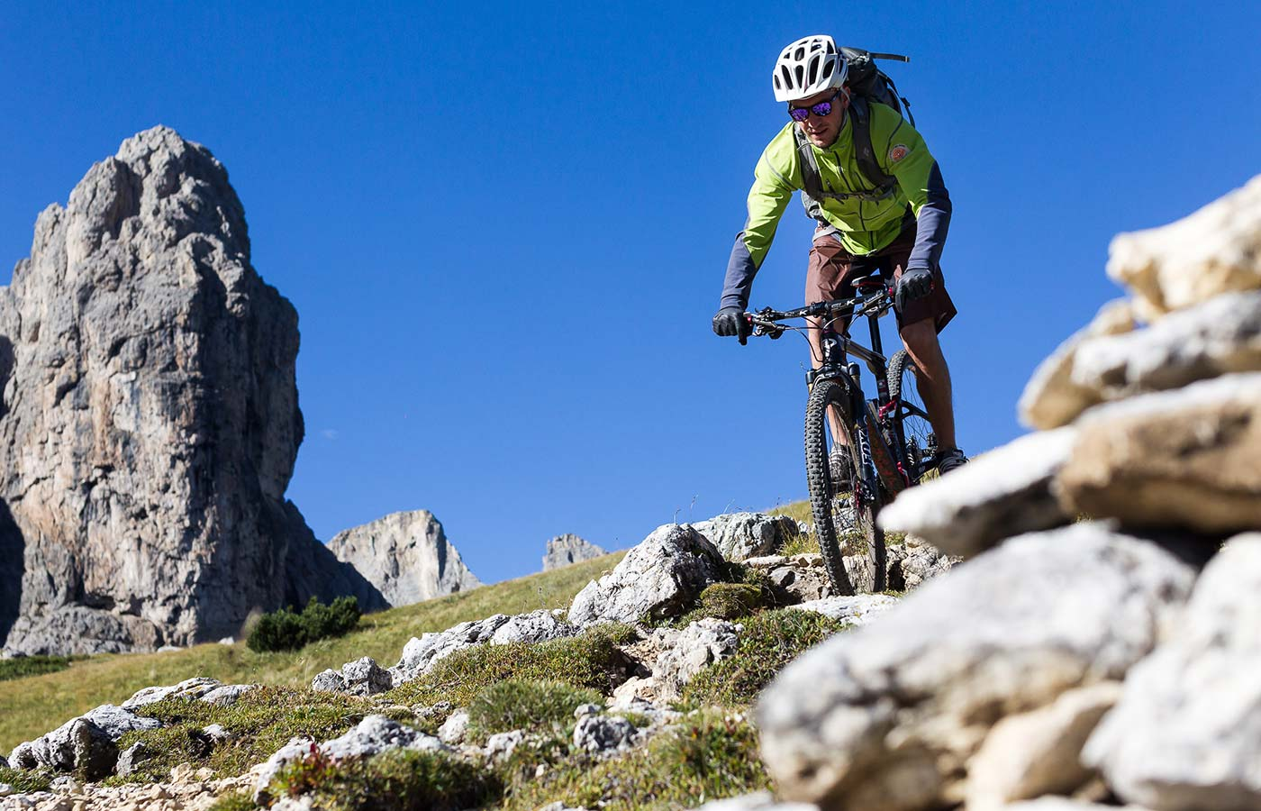 Mountain biker on an Alpine path