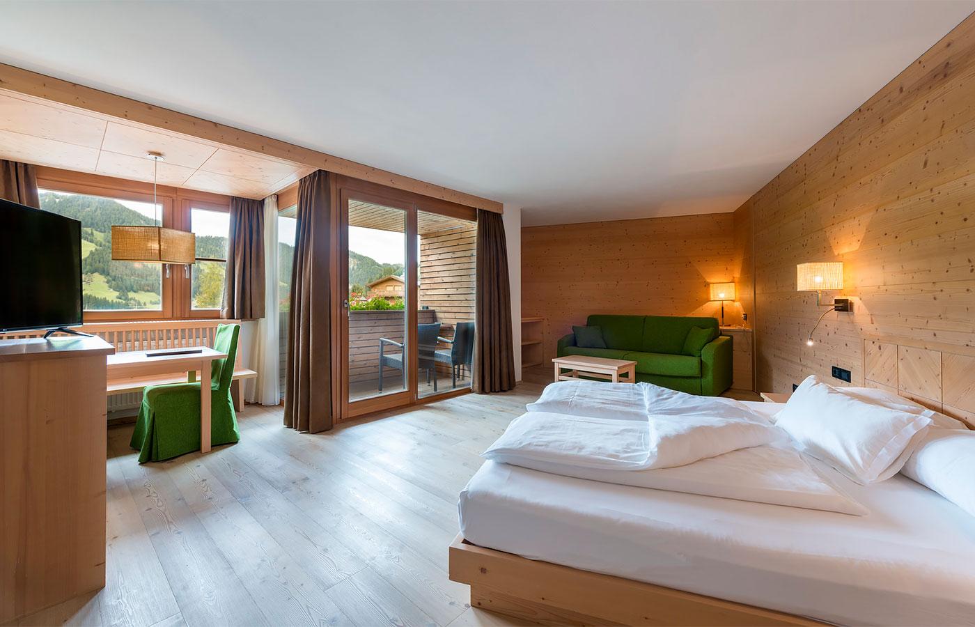 Camere in val badia scopri l hotel cavallino - Residence val badia con piscina ...