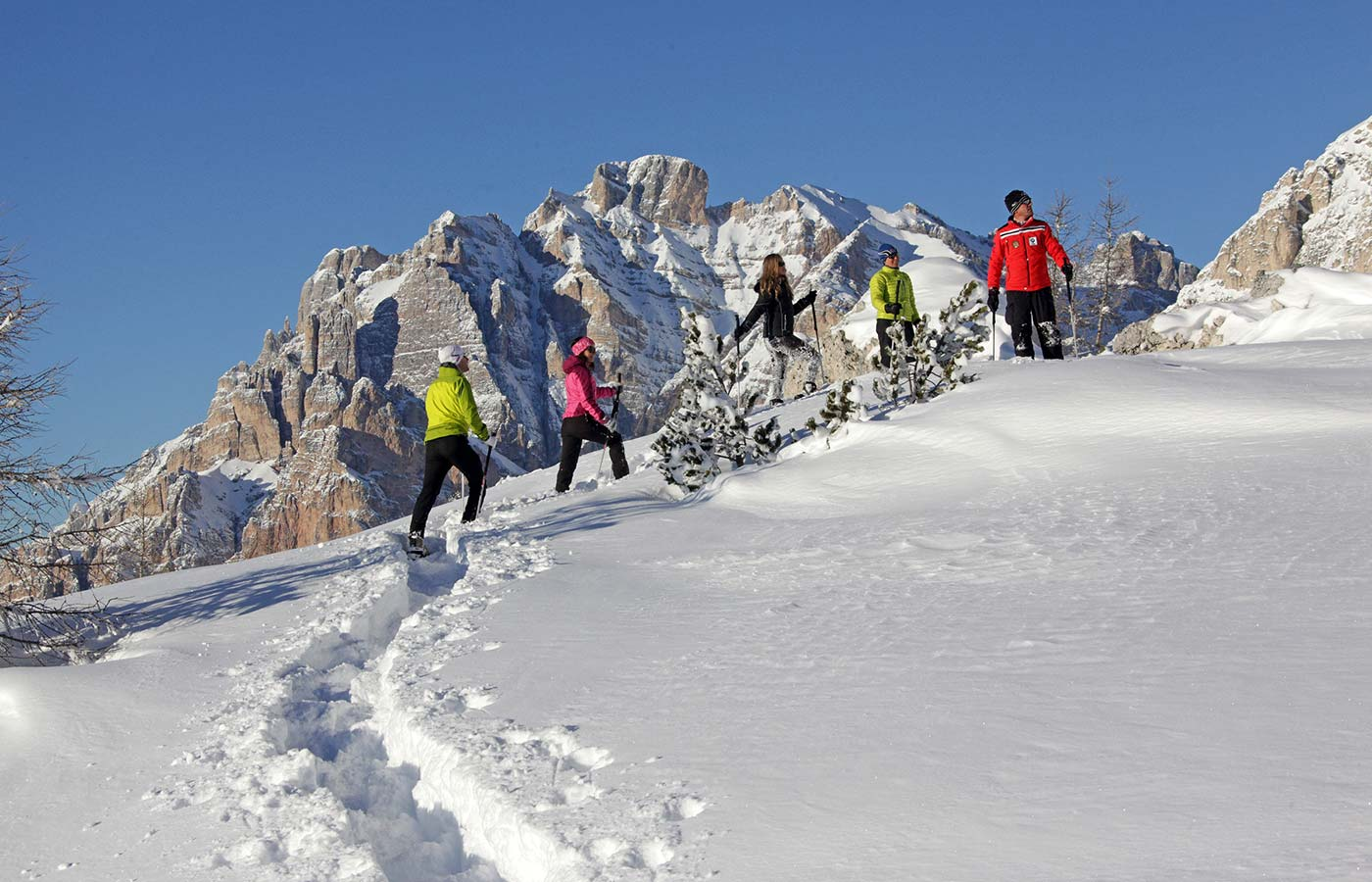 Snowshoe hiking with Dolomites at the back